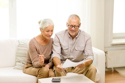 Elderly couple reviewing documents